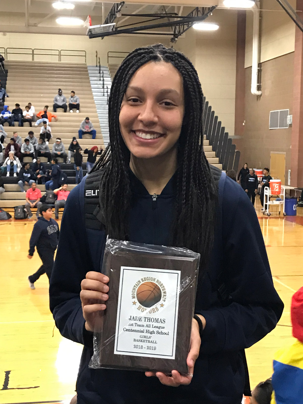 Jade Thomas holding her Mountain Region Northwest Honors