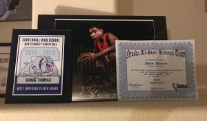 Shane Thomas' award and certificate for Men's Varsity Basketball